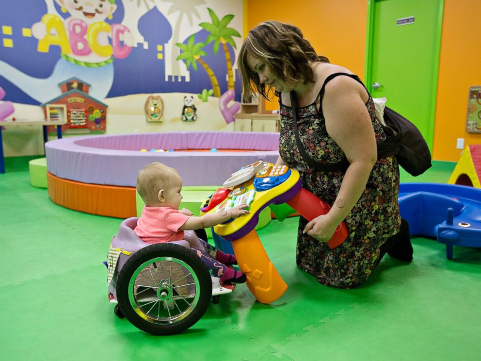PHOTO: Kim Moore and her one-year-old daughter Evelyn Moore play at an indoor play ground in Edmonton Alberta, Canada, Aug. 9, 2016. Evelyn, also called Eva by her family, was diagnosed with cancer following her four-month check up.