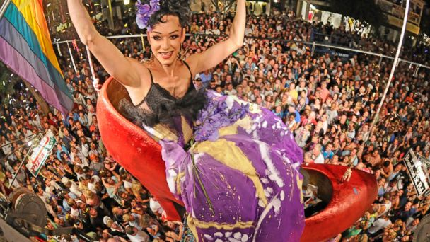 "PHOTO: In a photo released by the Florida Keys News Bureau, female impersonator Gary Marion, transformed into ""Sushi,"" hangs above Duval Street and thousands of New Years Eve revelers at the Bourbon Street Pub Complex in Key West, Fla."