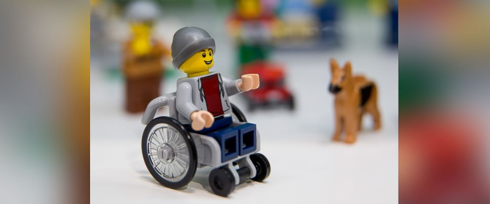 PHOTO: A Lego figure in a wheelchair can be seen next to a Lego dog at the stand for the Danish manufacturer Lego at the 67th International Speilwarenmesse toy fair in Nuremberg, Germany, on Jan. 28, 2016.
