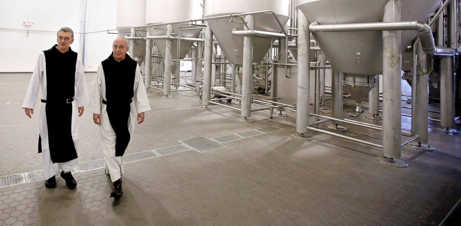PHOTO: Father Damion, abbot at St. Josephs Trappist Abbey and Spencer Brewery director Father Isaac walk through their new, state-of-the-art facility in Spencer, Mass.
