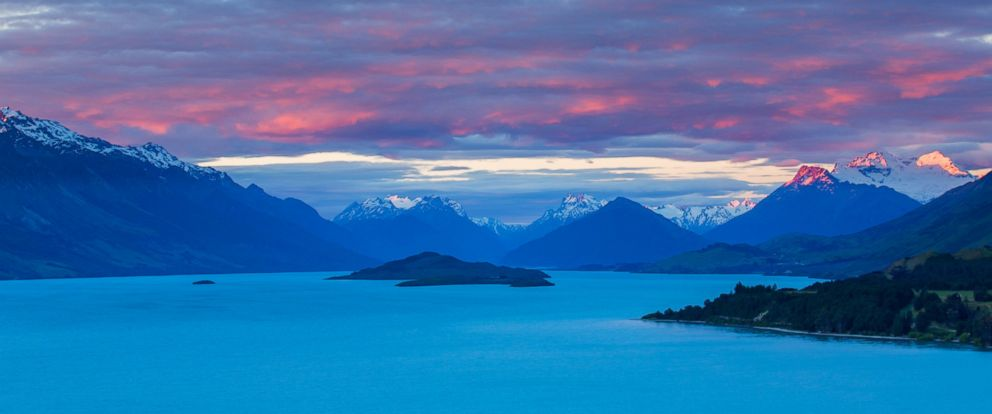 PHOTO: Mount Earnslaw and neighboring mountain peaks in the Southern Alps are lit with the last rays of the sun beyond Lake Wakatipu, Otago in South Island, New Zealand in this undated stock photo.