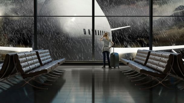 PHOTO: A woman is pictured on the phone at a rainy airport terminal in this undated stock photo.