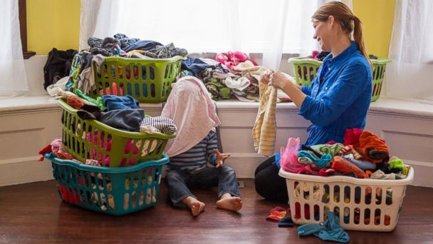PHOTO: Mother and child with laundry.