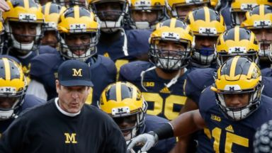 PHOTO: Head coach Jim Harbaugh of the Michigan Wolverines leads his team on the field before the start of their game against the Ohio State Buckeyes at Michigan Stadium on Nov. 28, 2015 in Ann Arbor, Mich.