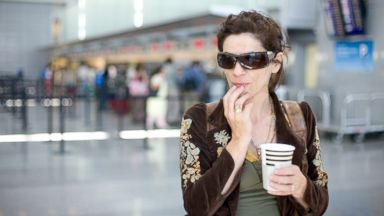 PHOTO: A woman waits for her flight at the airport in this undated stock photo.