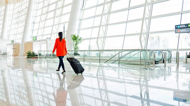 PHOTO: A young woman walks through the airport with luggage in this undated stock photo.