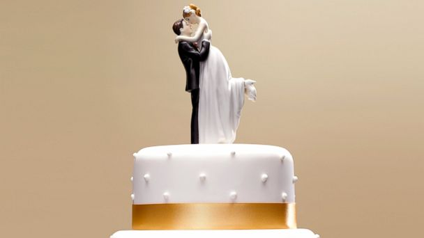PHOTO: Bride and groom topper on a wedding cake.