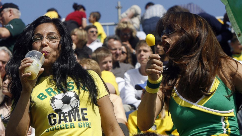 PHOTO: A Brazilian football fan enjoys a Caipirinha