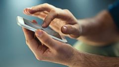 PHOTO: A man is pictured on his smartphone in this stock photo.
