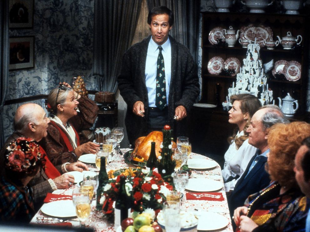 PHOTO: Chevy Chase stands at the head of the table in a scene from the film Christmas Vacation.