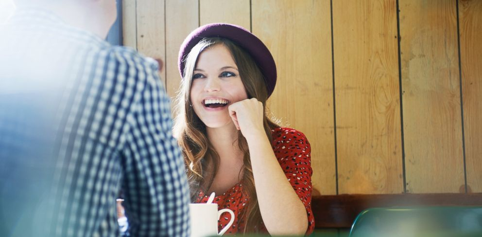 PHOTO: In this stock image, a woman and man are pictured chatting in a cafe.