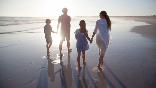 PHOTO: A family enjoys time together on the beach at sunset in this undated stock photo.