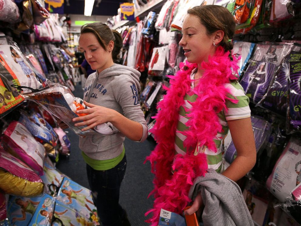PHOTO: Maggie Ryan, 13, left, and Meredith Sullivan, 13, right, shop for Halloween costumes in this file photo.