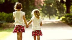 PHOTO: Two sisters take a walk together in this stock photo.