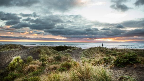 PHOTO: The sunset is pictured at the surf beach of Piha in Auckland, New Zealand.