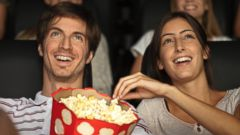 PHOTO: In this stock image, a couple is pictured eating popcorn in movie theater.