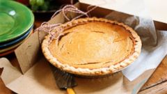 PHOTO: A pumpkin pie inside in a cardboard box.