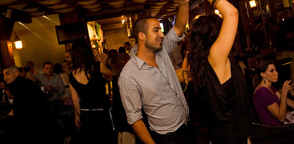 PHOTO: A Palestinian couple dance in the Orjuwan Lounge, June 24, 2010, in Ramallah, West Bank.