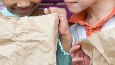 PHOTO: Students are pictured looking in their lunch bags in this stock image.