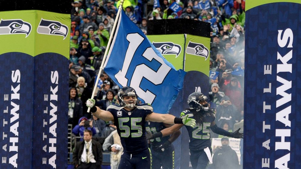 PHOTO: Linebacker Heath Farwell #55 of the Seattle Seahawks runs out of the tunnel with the 12th Man flag before taking on the New Orleans Saints during the NFC Divisional Playoff Game at CenturyLink Field on Jan. 11, 2014 in Seattle.