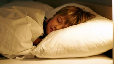 PHOTO: Mom admits she still enjoys sleeping with her six-year-old son.