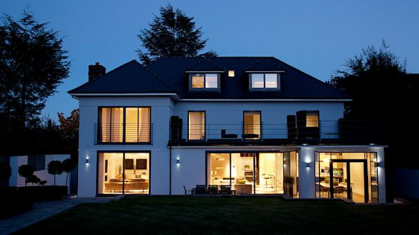 PHOTO: Modern house illuminated at night.