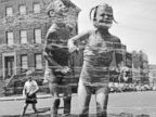PHOTO: Two children jump through a fire hydrants spray on a street in New York, circa 1950.