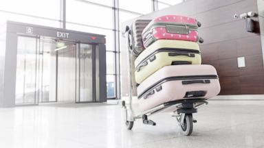 PHOTO: A baggage cart with suitcases at the airport is pictured in this undated stock photo.