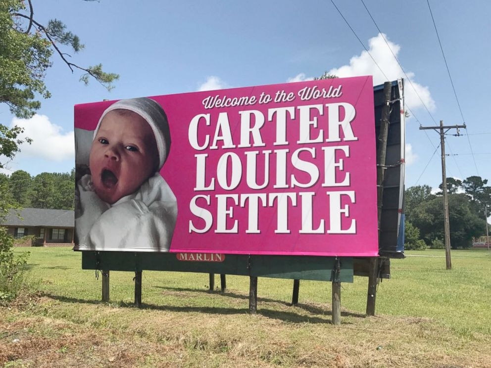 PHOTO: Kelen and Will Settle were surprised when his coworkers put up a giant billboard announcing their daughters birth along a South Carolina highway.