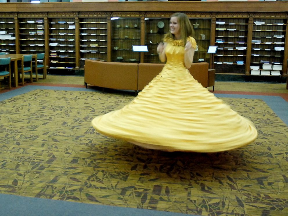 PHOTO: Joel Lynch pulled off a magical Beauty and the Beast proposal for Cara Szymanski complete with Belles yellow gown.