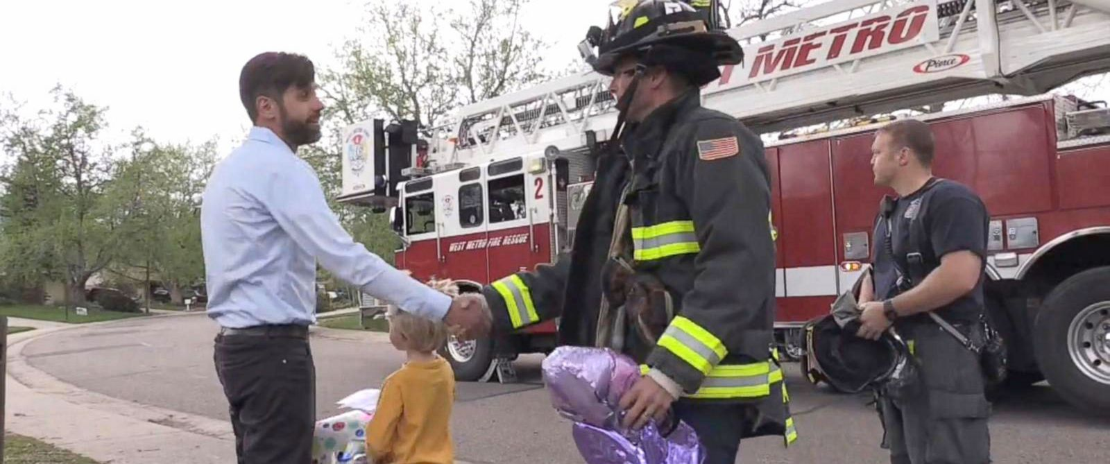"PHOTO: Firefighters of West Metro Fire Rescue in Lakewood, Colorado, helped a boy retrieve his balloon from a tree that he sent up to ""heaven"" for his mom."