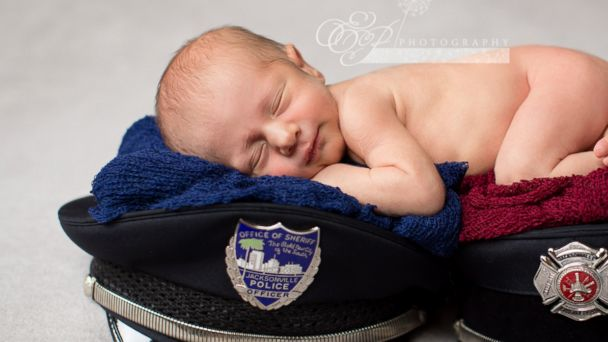 PHOTO: Enzo Anthony Crnolic, 1 month, posed for a newborn photo shoot with his mom's firefighter hat and his dad's police cap.