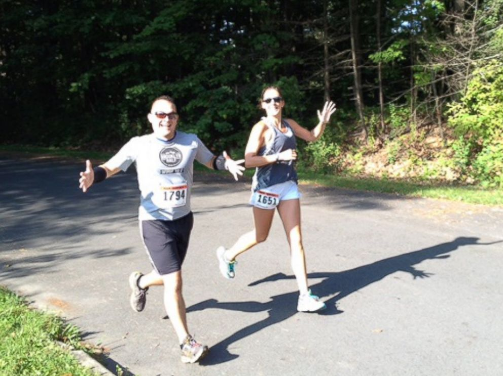 Alexander Salazar and Krissa Cetner running in the Sarasota half marathon.