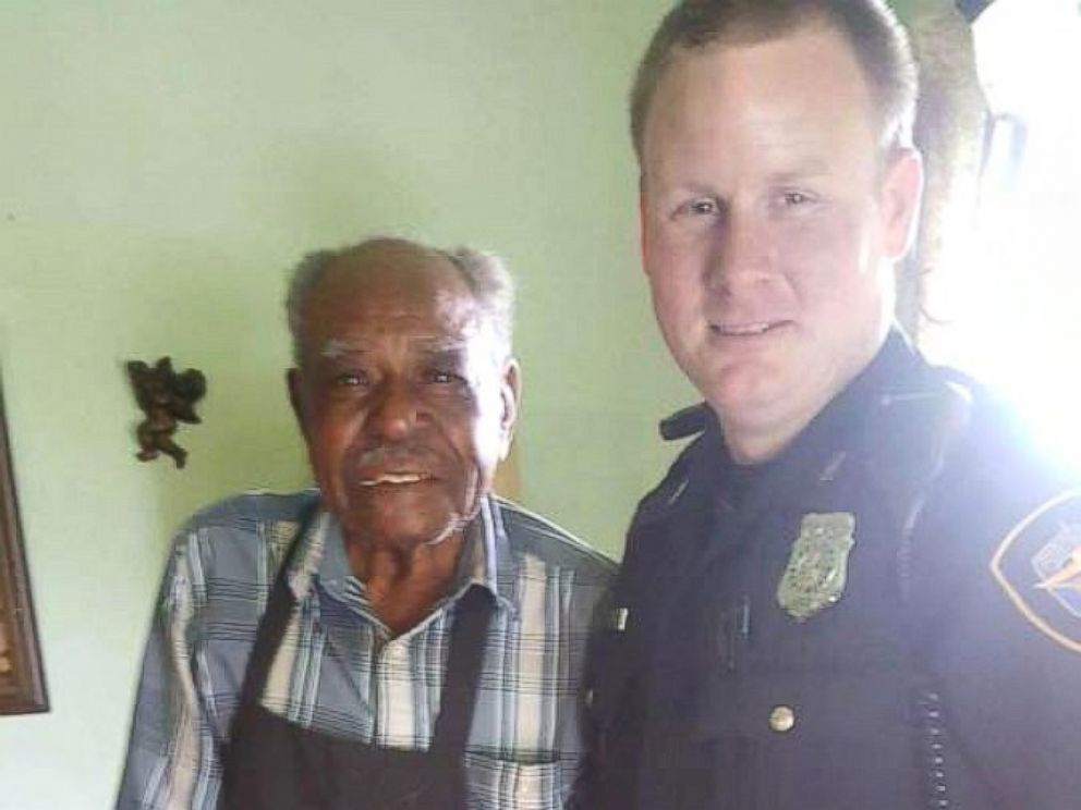 PHOTO: Officer Christopher Weir, 31 and Julius Hatley, 95, are seen here on June 8, 2017, after the Forth Worth Police Department answered a call from Hatley who dialed 9-1-1 when his air conditioning broke inside his home.