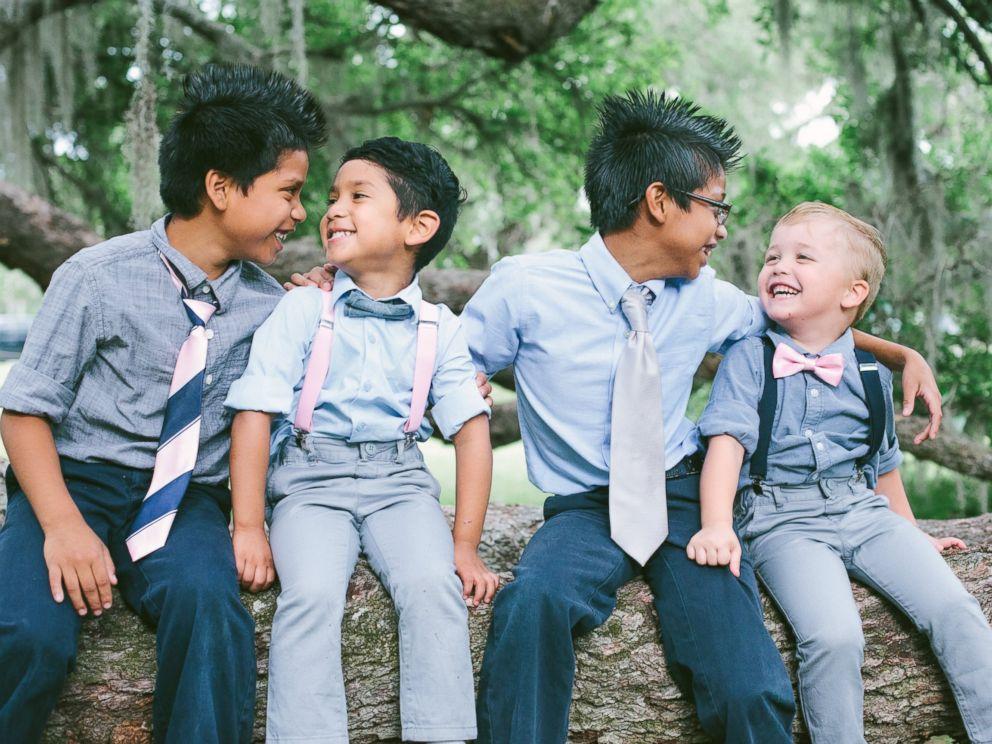 PHOTO: Josh and Jessaka Clark pose with their eight children in family photos taken in April 2017.