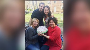Daughter surprises mom with pregnancy announcement disguised as birthday cake