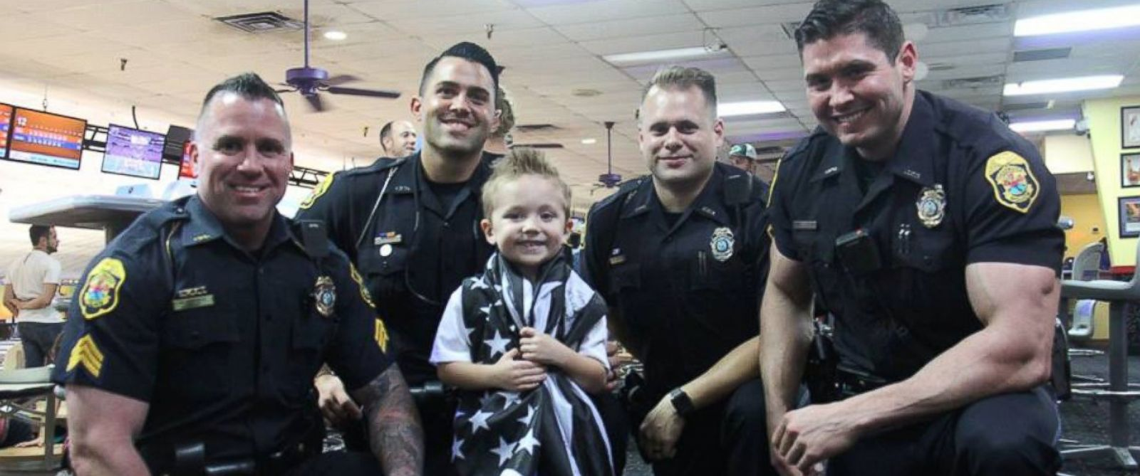 florida officers surprise pint size fan at police themed birthday