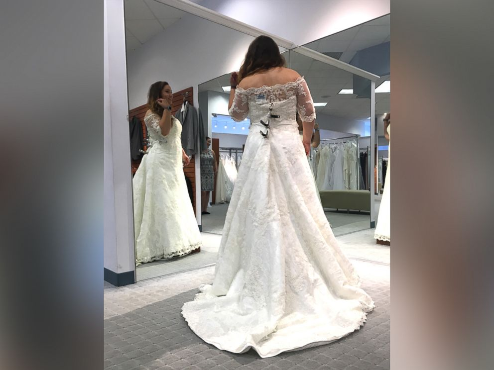 Brides to be offered free wedding gowns after dress chain closes photo amber mcgraw poses in the wedding gown she chose at an alfred angelo store junglespirit Images