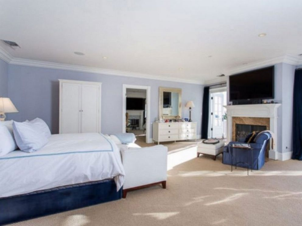 PHOTO: This huge bedroom - one of seven in the home - boasts a fireplace and views of Beverly Hills.