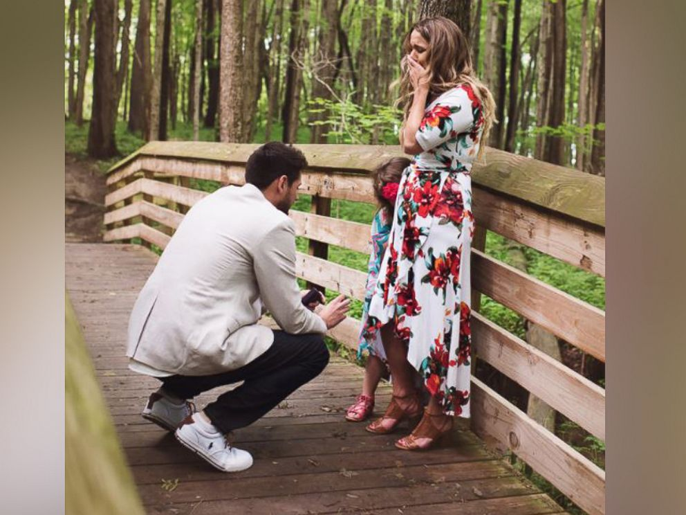 PHOTO: Grant Tribbett proposes to his girlfriend Cassandra Reschar and her 5-year-old daughter, Adrianna, on May 27, 2017.