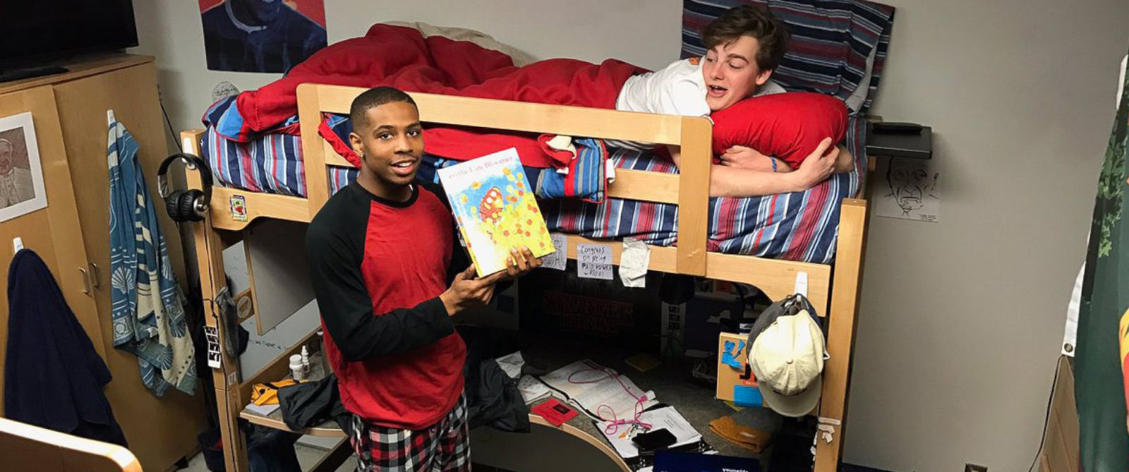 PHOTO: After University of Tennessee resident assistant Quamir Boddie asked his students what they needed to feel at home, he fulfilled Andrew Kochambas request of reading him a bedtime story.