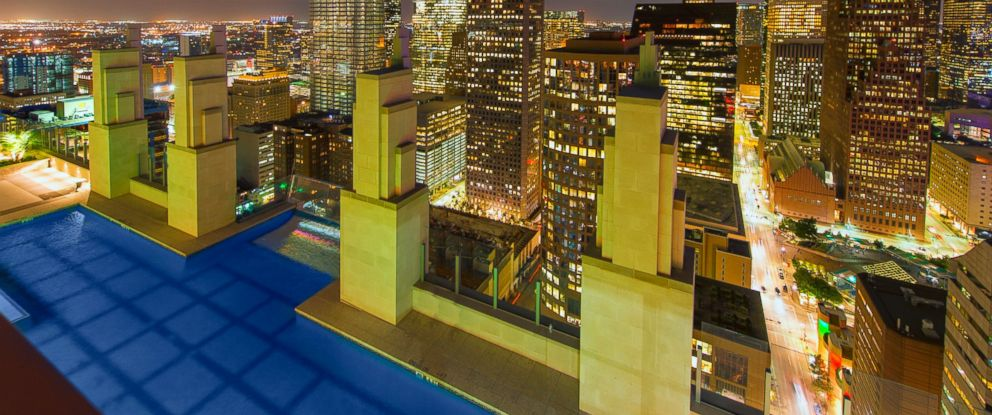 PHOTO: A portion of a Texas apartment complexs rooftop pool juts out 500 feet above downtown Houston.