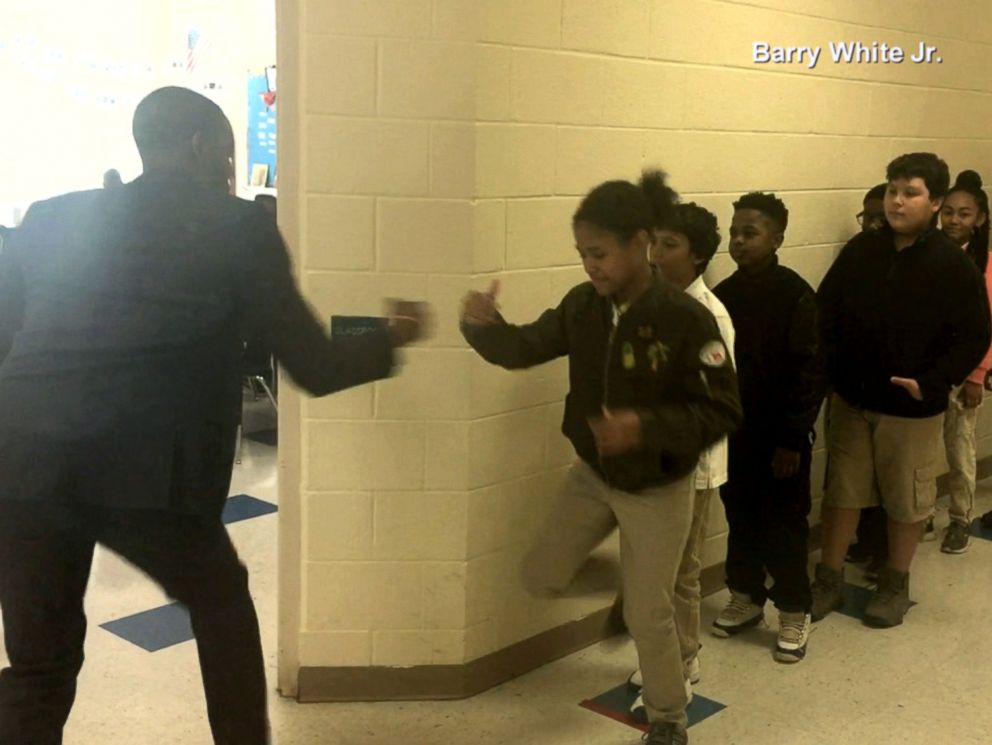Incredible  teacher has unique handshake for each student