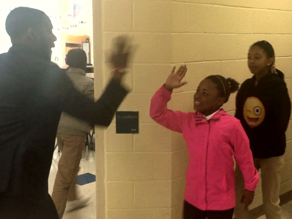 PHOTO: Barry White, Jr., a fifth grade teacher in Charlotte, North Carolina, personally shakes hands with every single one of his students.