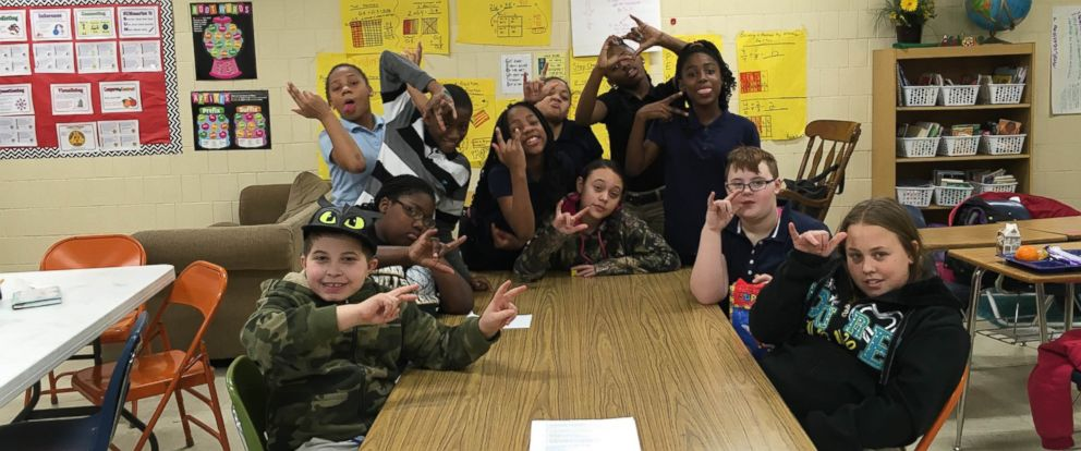 PHOTO: Students at Mark Bills Middle School in Peoria, Illinois created a sign language club to better communicate with a deaf student.