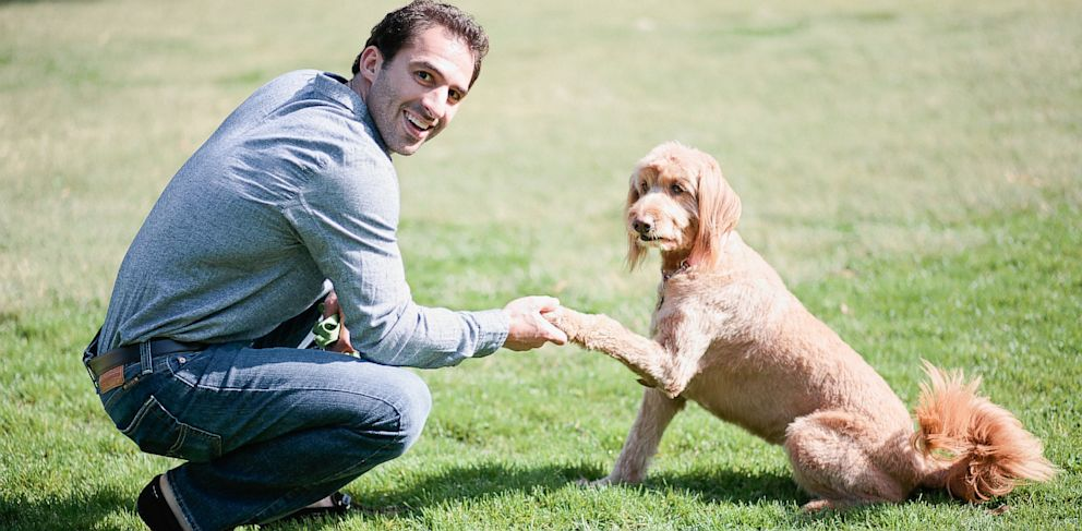 PHOTO: DogVacays co-founder and CEO, Aaron Hirschhorn with one of his own dogs, Rocky.