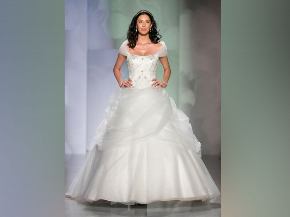 Disney reveals new princess wedding dresses abc news for Designer disney wedding dresses