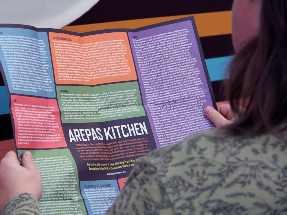 PHOTO: A customer reads a leaflet on Venezuela.