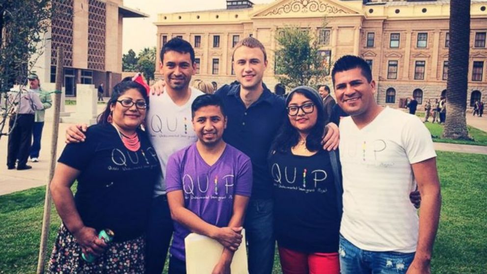 PHOTO: Dago Bailon, center, stands in front of the capitol, with members of the Arizona Queer Undocumented Immigrant Project.