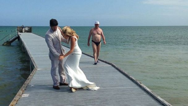 HT Speedo Wedding Photobomb EM 16x9 608 Scantily Clad Beachgoer Photobombs Newlyweds Big Day